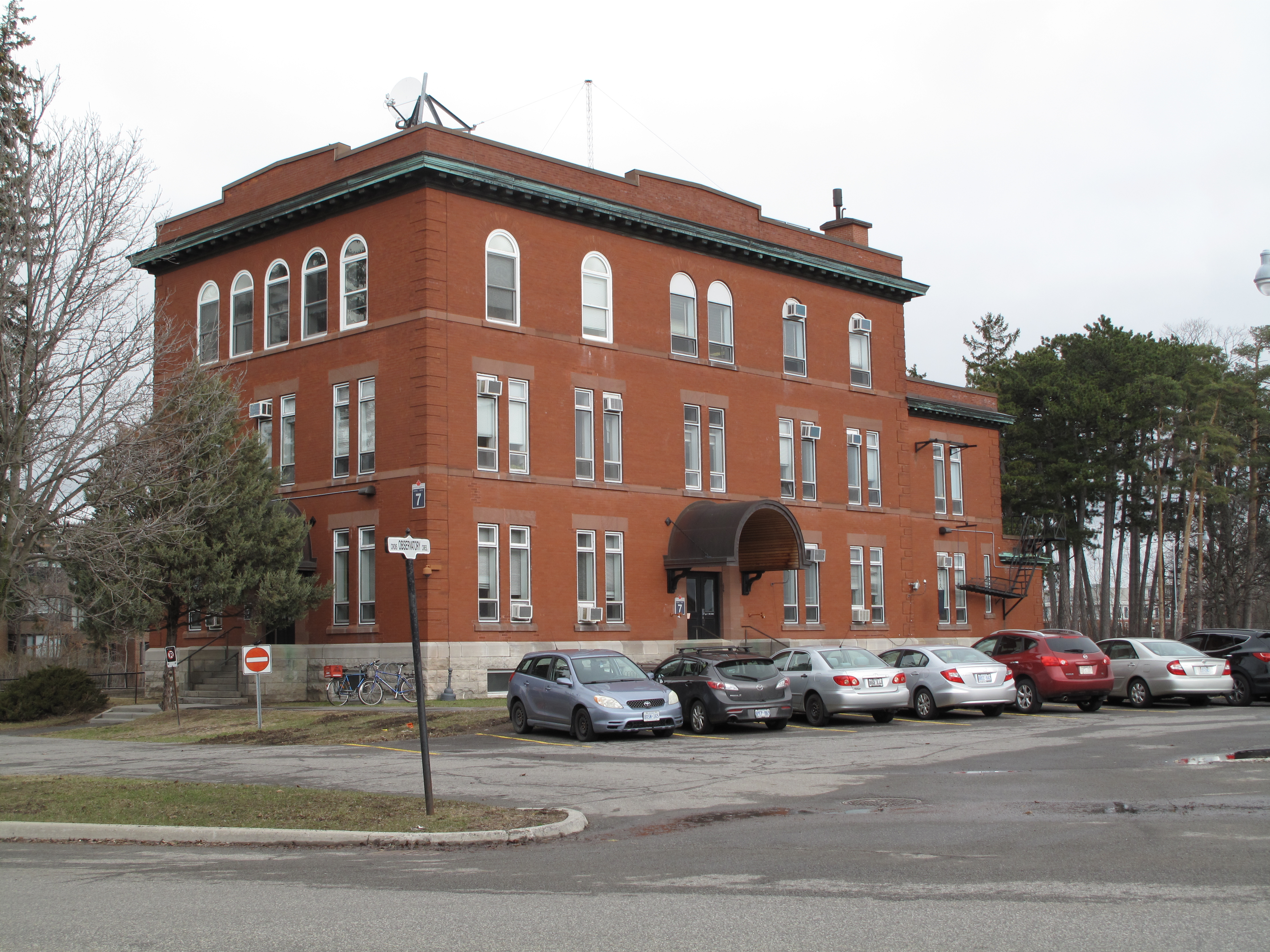 Exterior view of the three-storey rectangular brick building with a flat roof built in 1914.