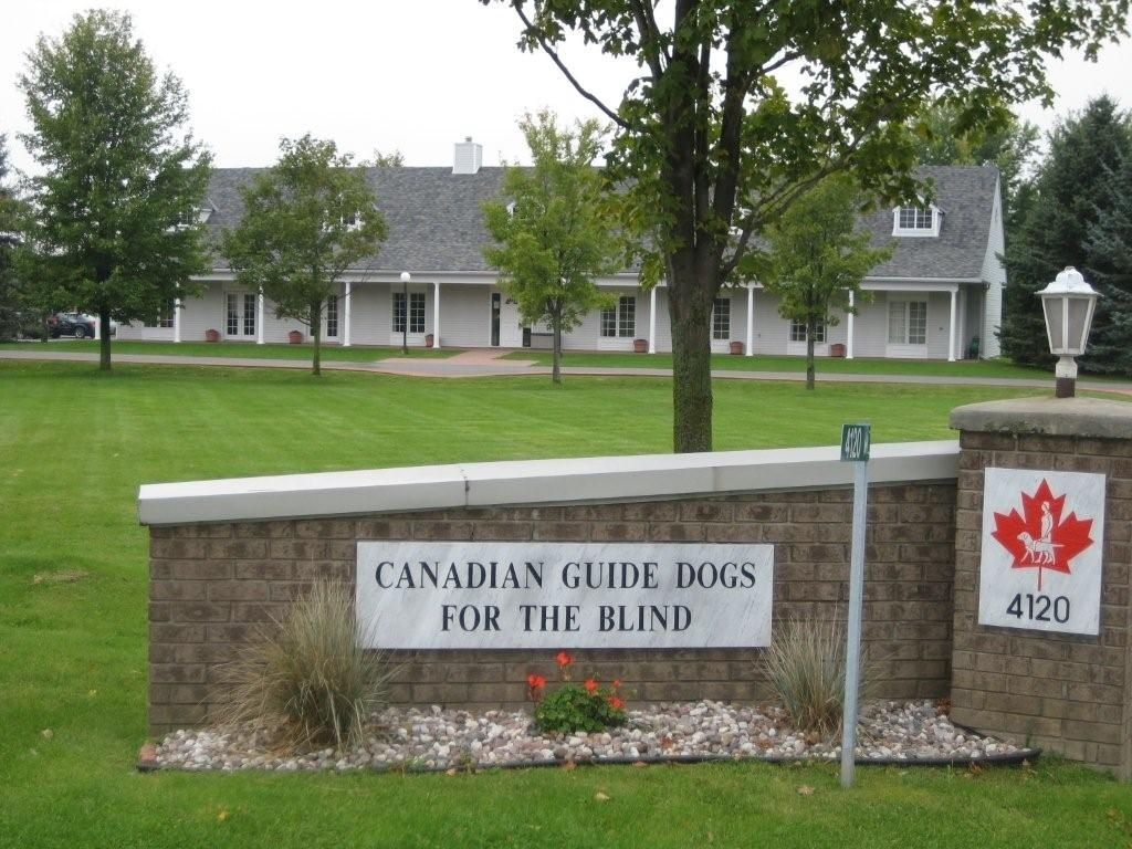 Exterior view of the Canadian Guide Dogs single storey building and the organization's signage.
