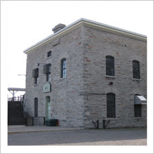 Exterior view of a stone building built in 1891 featuring the oldest operating hydroelectric generator in Canada.