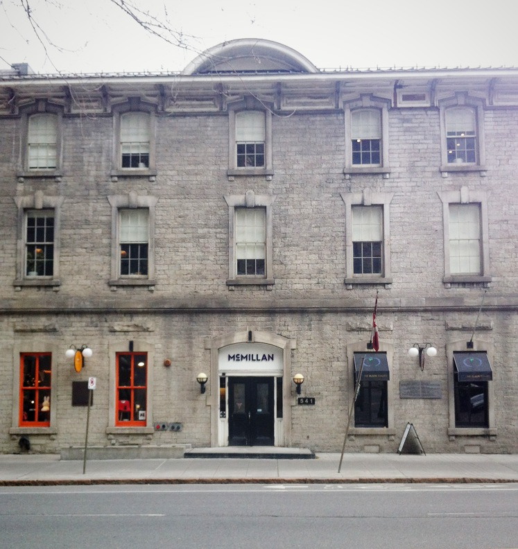 Exterior view of a three-storey stone building which was once used as military barracks by Sir John A Macdonald.