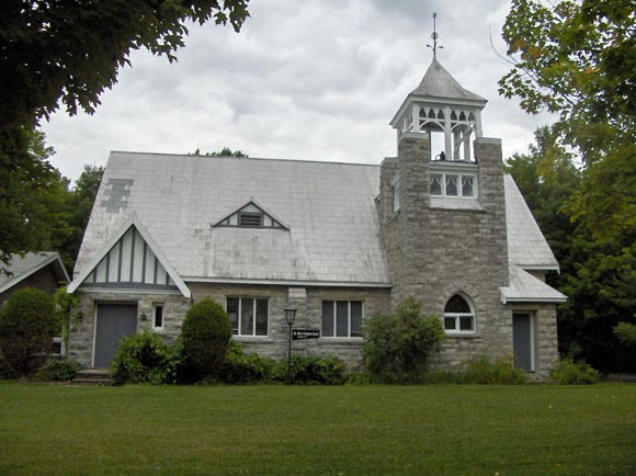 Exterior view of a stone church built in 1909.