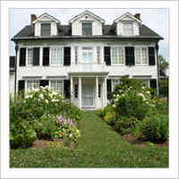 Built from 1827 to 1829, Ottawa's oldest wood-frame house is white with black shutters, features a second storey balcony, and  lush summer gardens.
