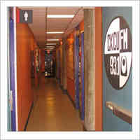 Interior view of the radio centre corridor and a CKCU radio sign.