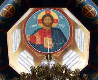 Interior view of one of three domes painted with a portrait of Jesus  on the ceiling surrounded by windows at the Byzantine church built in 1968.